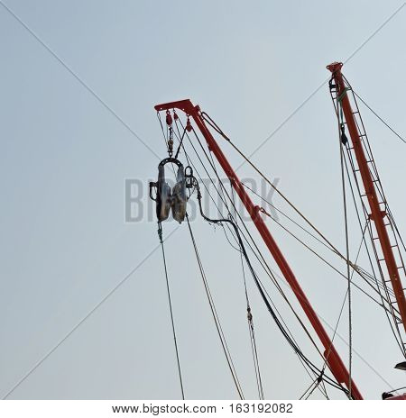 Pulley and ropes on a fisherboat with the sky background