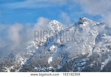 alpine mountain peaks iover blue sky n winter
