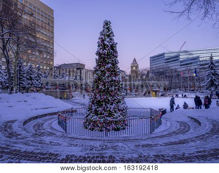 CALGARY, CANADA - DEC 25: Families ice skating at Olympic on December 25, 2016 in Calgary, Alberta. The ice skating at Olympic Plaza is a popular winter activity for Calgarians.