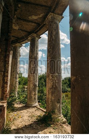 Old rounded balcony, terrace with columns, an abandoned manor of Earl Voeikov