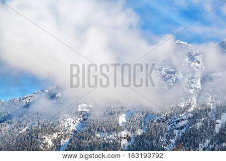 clouds over alpine winter peaks Karwendel Germany