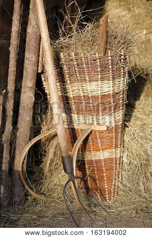 pitchfork and basket for the hay harvest
