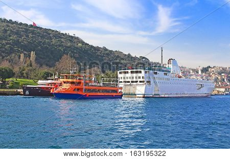 Ferry boat and pleasure boats in Bosphorus, Istanbul, Turkey
