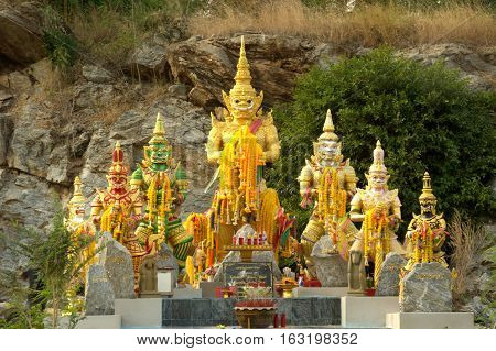 SUPHANBURI,THAILAND-DECEMBER 11,2016 : Group of giant guardians statue on Pha Mungkonbin cliff in Wat Khao Tham Thiam , U Thong District ,Suphanburi District in Middle of Thailand.