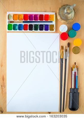 Drawing Supplies Watercolor Brushes, Aquarelle, Gouache, Paper On Wooden Background