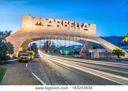 Marbella Spain - December 26 2016: Marbella Entrance Arch at dusk