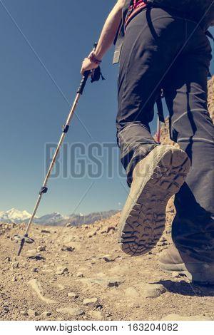 Closeup of trekking shoes on a desert surface. Trekking a desert path.