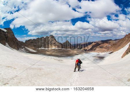 Climber going to the glacier in Tien Shan,