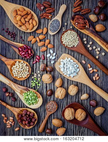 Various Legumes And Different Kinds Of Nutshells In Spoons. Walnuts Kernels ,hazelnuts, Almond ,brow