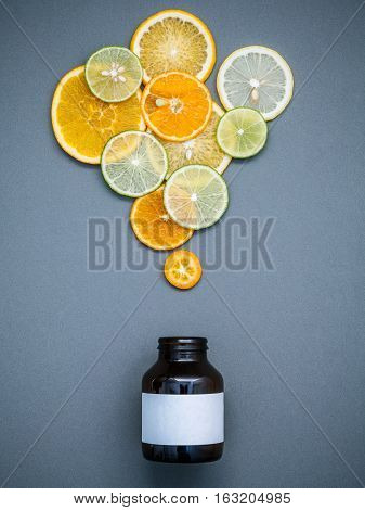 Healthy Foods And Medicine Concept. Bottle Of Vitamin C And Various Citrus Fruits. Citrus Fruits Sli