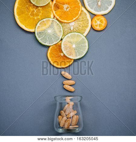 Healthy Foods And Medicine Concept. Bottle Of Vitamin C And Various Citrus Fruits. Mixed Citrus Frui