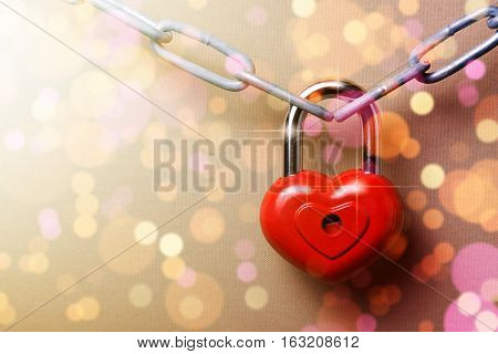 Castle in the shape of a heart on a chain on bokeh background.