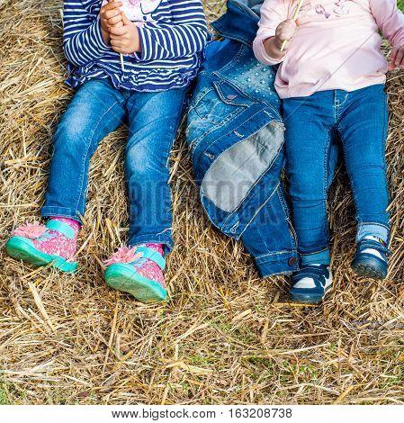 Girls in jeans posing in the hayloft