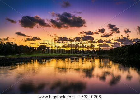 Beautiful Sunset Over The Lake Near The Golf Course In A Tropical Resort, Punta Cana