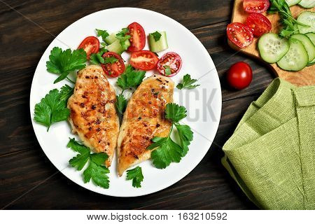Grilled chicken breast and vegetable salad top view