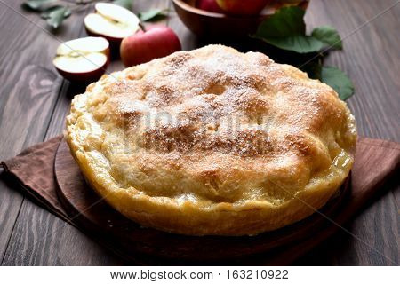 Apple pie on wooden table close up view