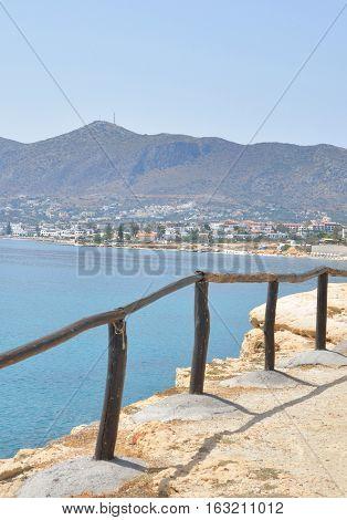 Fence on the coast of Cretan Sea near Hersonissos Crete Greece.