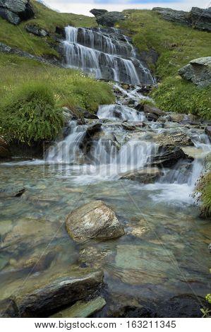waterfall in palasinaz mountains in italian alps
