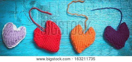 Valentine's Day. Colorful knitted hearts. Red heart on the blue boards. Valentines day. Red heart. Valentine cards. Letter box look. Eighth of March. International Women's Day. Toned image.