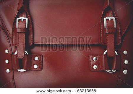Red glossy female leather bag. With vintage toning effect