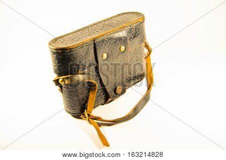 Old rangefinder camera in leather case on white background