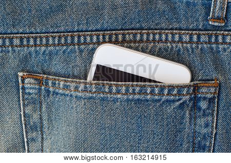 Smart phone in the back pocket of jeans closeup