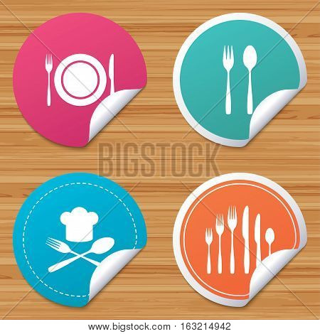 Round stickers or website banners. Plate dish with forks and knifes icons. Chief hat sign. Crosswise cutlery symbol. Dessert fork. Circle badges with bended corner. Vector