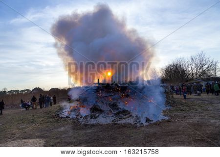 ZEMPIN USEDOM - MAR 26 2016: people enjoy the easter fire in Zempin Germany. Easter fire is an old german tradition.