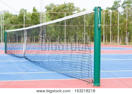 Tennis blue hard court with the net