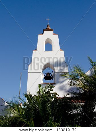 Steeple Of Star Of The Sea Church Over Palm Trees