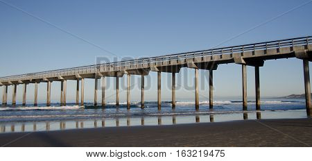 Reflections In Sunrise Under A Tall Pier At La Jolla Bay