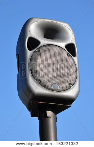 Music column against the sky. Speaker system.