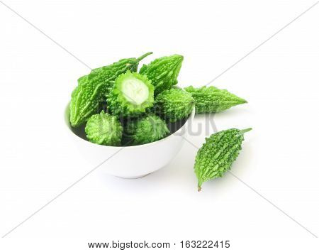 Momordica charantia in bowl on white background