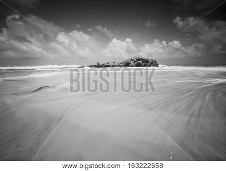 Beautiful seascape view with dramatic sky and motion wave in black and white. Composition of Nature.