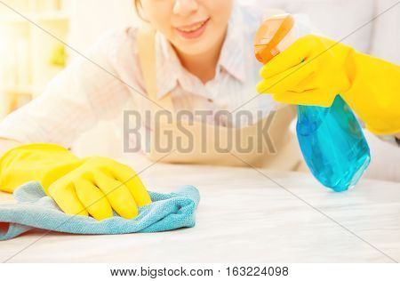 Housewife In Yellow Gloves Cleaning Table