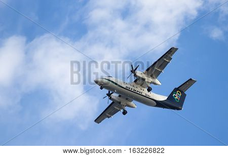 RHODES, GREECE - SEPTEMBER 20 2016: Olympic Air aircraft comes in to land on the background of blue clear sky