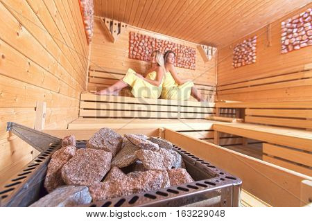 Beautiful Women In A Sauna.