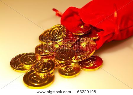 From Red Sack Scattered Pile Of Golden Coins