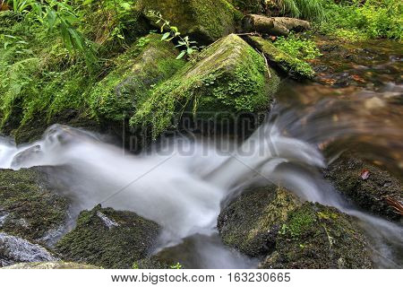 Abstract detail of the water flowing over rocks