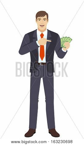 Businessman pointing at money in his hand. Businessman with money. Full length portrait of businessman in a flat style. Vector illustration.