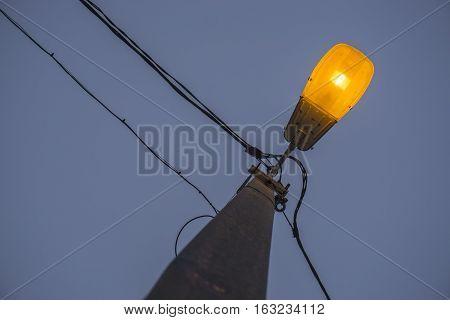 Street yellow light against night sky background