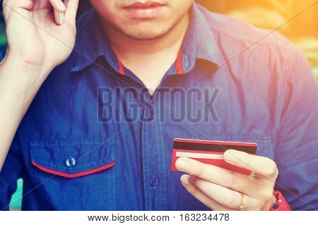 Man Calling To Customer Service With Checking About Problem Credit Card.