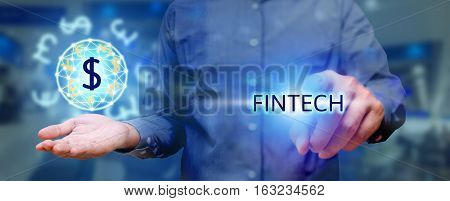 Finacial Technology Concept, Man Pressing Text Fintech And Holding Global Currency.