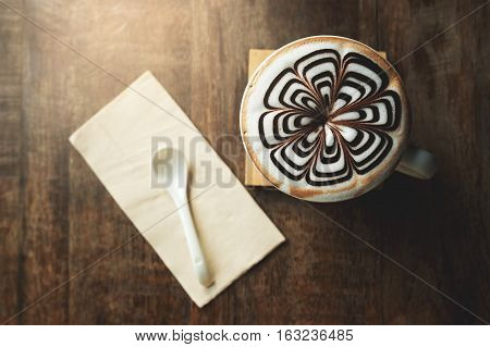 A cup of coffee on wood background copy space backgroung