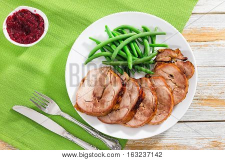 Roast Meat Roulade Cut In Slices With Boiled Green Beans