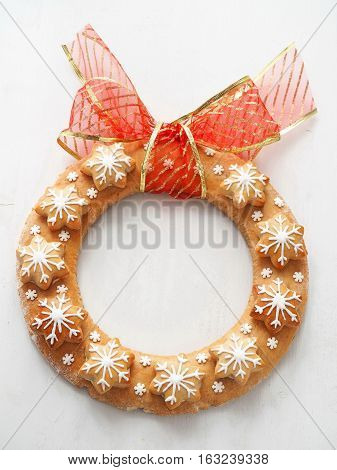 Christmas wreath made of gingerbread. Decorated shortbread cookies in the shape of Christmas wreath and stars. Top view.