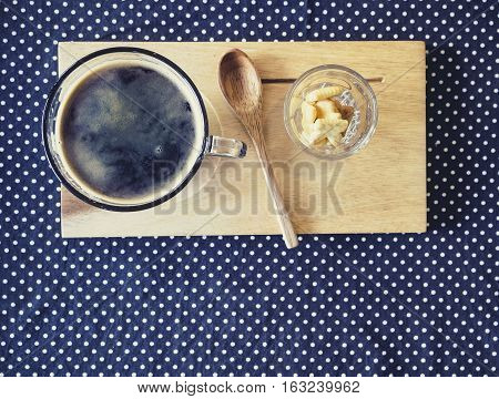 Cup of coffee on wooden tray spoon with crackers Drink Vintage tone