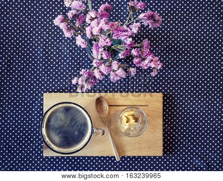 Coffee cup on table Little Flower decoration Hipster style Vintage Tone