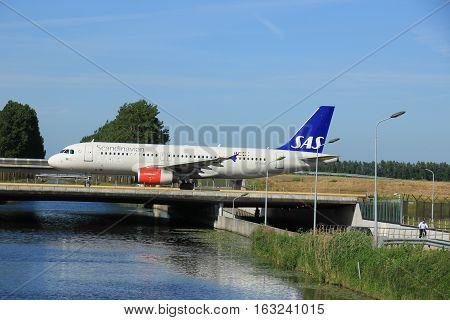 Amsterdam the Netherlands - June 9th 2016: OY-KAO SAS Scandinavian Airlines Airbus A320 taxiing to Polderbaan runway Schiphol destination Copenhagen Denmark