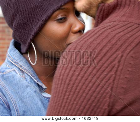 Close-up of a man hugging a woman and